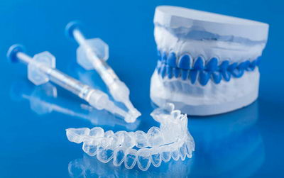 Сколько стоит домашнее отбеливание зубов капами